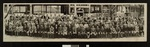 Panoramic view of Luther Theological Seminary student body and faculty in front of the new library and classroom building under construction, 1946, St. Paul, Minnesota